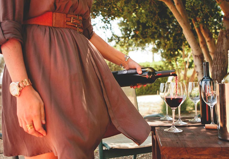 Woman pouring a glass of red wine