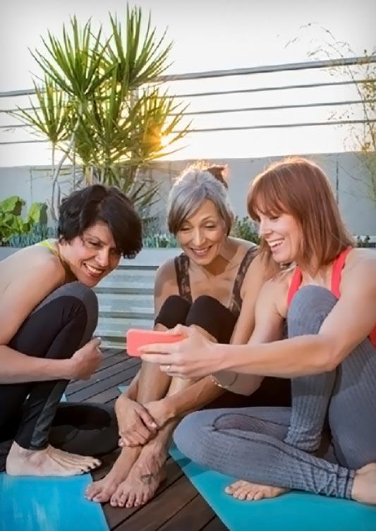 Three women doing yoga together