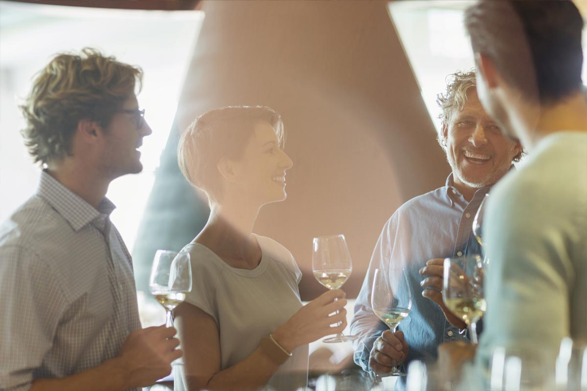 A group of friends having a good time wine tasting.